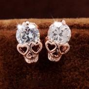 Crâne en alliage de diamant en alliage d'or rose punk avec boucles d'oreilles