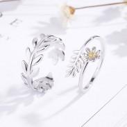 Romantiques doux feuilles d'argent branche de fleur de plume ouverture des anneaux de couple