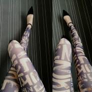 Tissu conçu de fille de mode dessin animé griffonnage impression maille neuvième leggings de dentelle