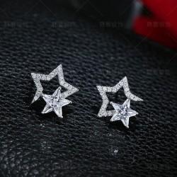Boucles d'oreilles uniques en cristal de deux étoiles en argent sterling
