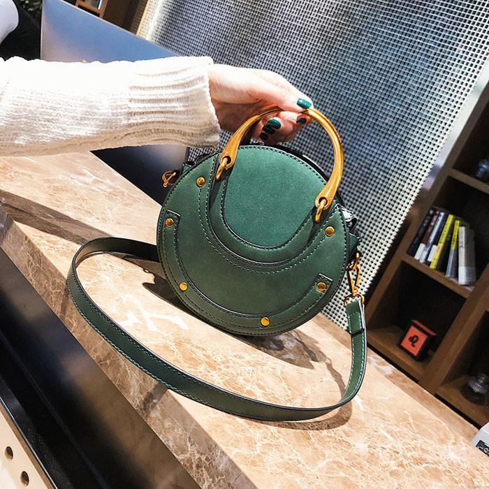Design unique petit sac rond sac à main à coutures givrées sac à bandoulière pour femmes