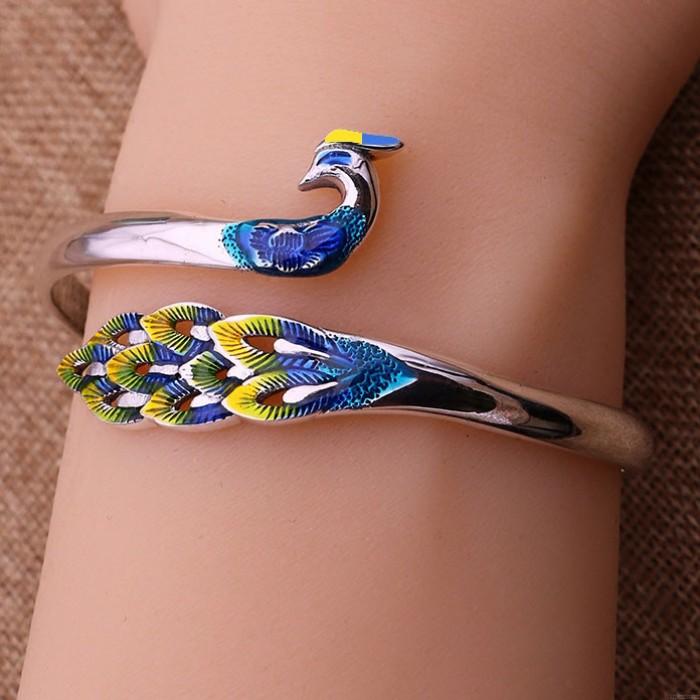 Bracelet fait main d'animal national réglable de paon de conception unique d'argent