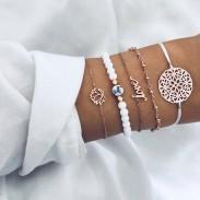 Sencillo Temperamento Lotus Jewelry Hollow Flower Love Cuentas de turquesa Conjunto de cinco piezas Pulsera de mujer
