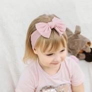 Preciosa diadema infantil de nylon de fuerza elástica Diadema ancha para bebé con lazo lateral