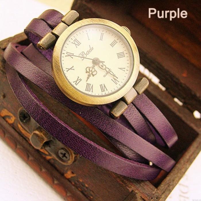 Estilo retro de moda vintage con múltiples envolturas de correa delgada y reloj retro
