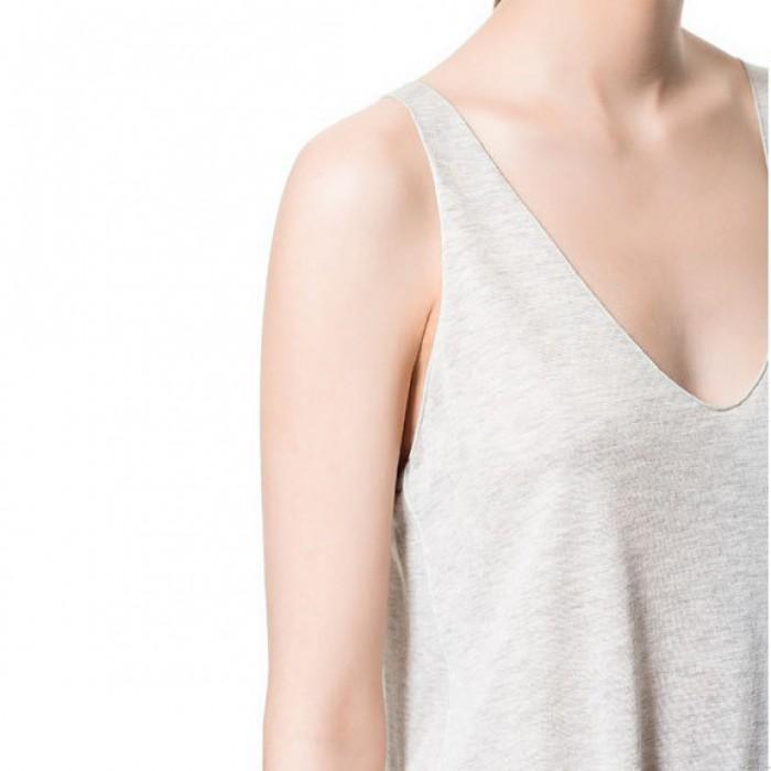Casual sexy color sólido modal v-cuello arco dobladillo chaleco Smock