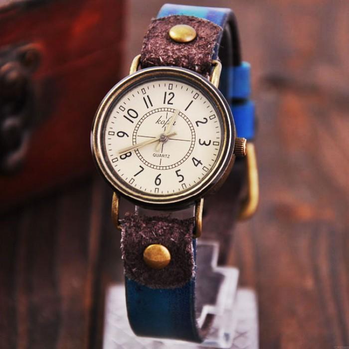 Reloj de pulsera resistente al agua de mujeres de cuero de cuarzo clásico retro