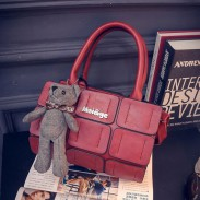 Neue Herbst-Zylinder-Handtasche reizende Bären-Anhänger Spleiß Schulter Umhängetasche