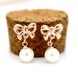 Arbeiten Sie eleganter Bogen Perlen Ohrringe