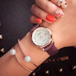 Elegante kortikale Frauen-wasserdichte Diamant-Kalender-Quarz-Armbanduhr